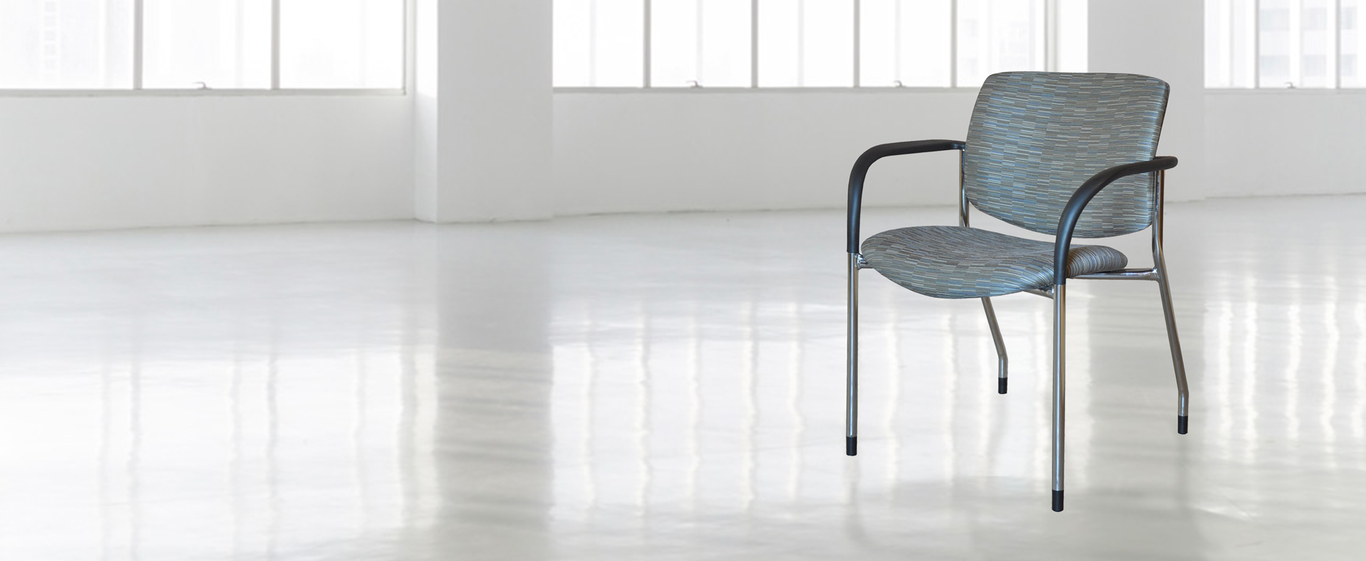 Jem lobby chair with black arms and chrome frame